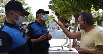 """Maske takmadığı için ceza yedi, polislere """"İyi maaşınız çıktı"""" dedi"""